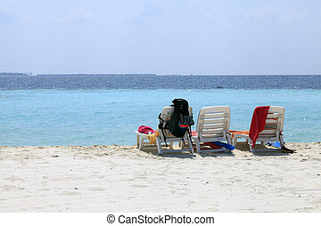 Beach chairs with miscellaneous stuff