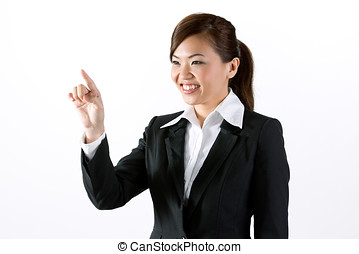 businesswoman pointing finger at a virtual screen - Asian...