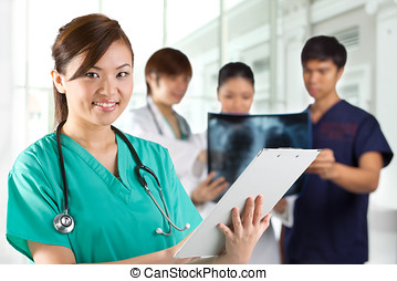 Asian healthcare workers. - Asian Female doctor wearing a...