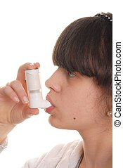 Girl with Inhaler - Teenage girl holding an inhaler isolated...