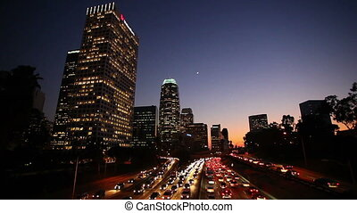 LA Downtown Traffic at Sun - Busy Freeway in Los Angeles,...