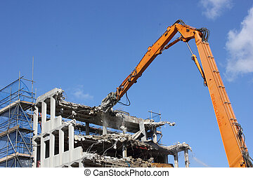 Demolishing of a building - The mechanical demolishing of an...