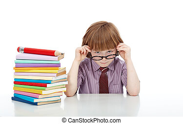 Little boy with glasses and lots of books