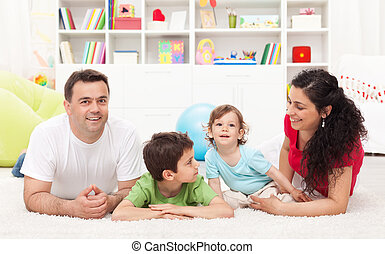Young family playing in the kids room