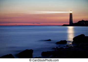 Lighthouse on the coast - Seascape at sunset. Lighthouse on...