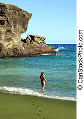 Green sand beach - Young woman on a green sand beach on Big...