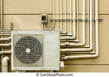 Air conditioning unit sitting outside and Pipe Line on wall