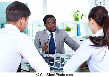 Boss talking - Portrait of serious boss interacting with his...
