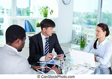 Debates - Portrait of business team interacting at meeting...