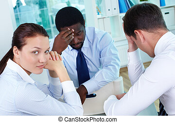 Bad luck - Portrait of sad business team sitting in office