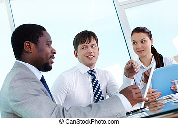 Explanation - Portrait of two employees listening to...