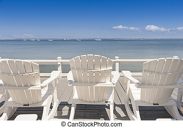 Ocean view - beach chairs overlooking tranquil ocean on old...