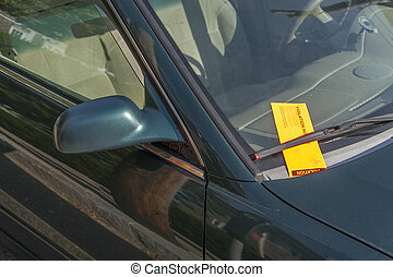 parking ticket on a car windshield