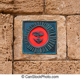 The red symbol on the wall of a smile