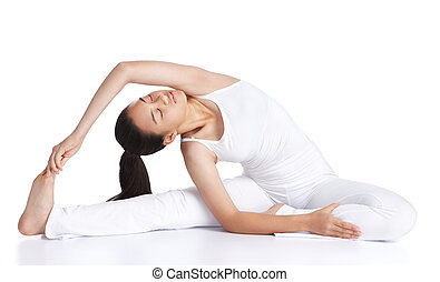 exercising yoga - female asian teenager doing yoga against...