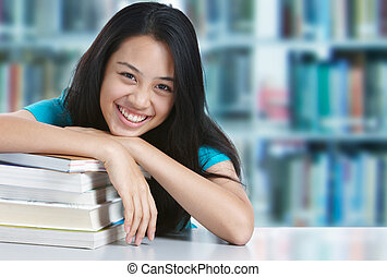 college student smiling - teenage girl smiling with stack of...