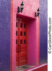 The Red Door - A red double door in a purple and pink...