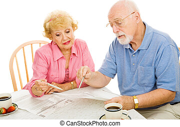 Seniors Voting from Home - Senior couple filling out their...