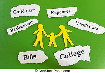 family budget - Paper cutout family with expenses on torn...