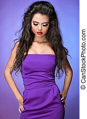 beautiful fashionable brunette woman over violet