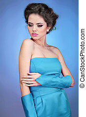 Fashion model, attractive woman in dress on blue bright...