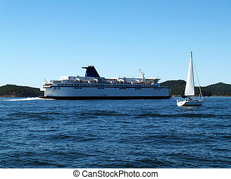 Large Ferry and Sailboat Underway on Bay - Large Ferry Boat...