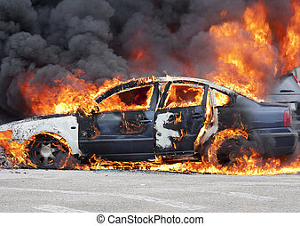 burning - a burning car in the middle of the street