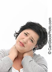 Woman with neck pain standing with her head tilted and hands...