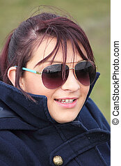 Young Lady wearing sunglasses - a young lady wearing...