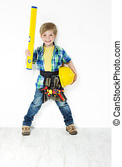 Little boy handyman with hard hat, level and tool belt
