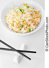 bowl of rice - bowl of vegetable fried rice and chopstick....