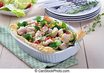 Fish fillet on vegetables