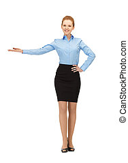 smiling stewardess showing direction - picture of smiling...