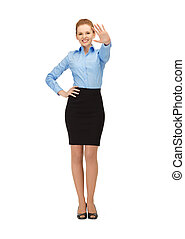 stewardess making greeting gesture - happy and smiling...