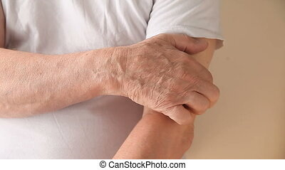 man with itchy upper arm - a man scratches a persistent itch...