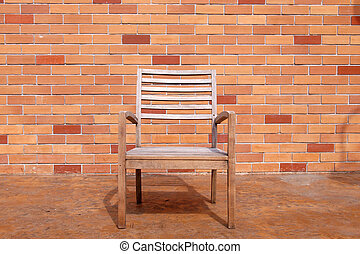 bench against a brick wall