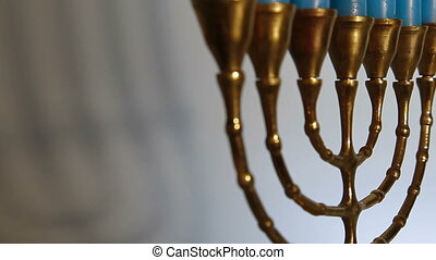 DOLLY: Menorah Candles - Menorah candles, tracking shot,...