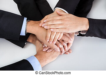 Business colleagues with hands stacked together - Closeup of...