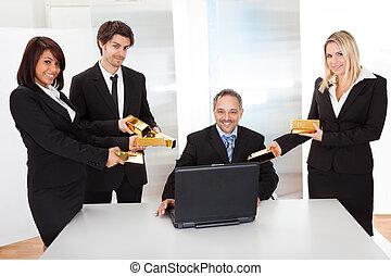 Businessman receiving gold bars - Portrait of happy...