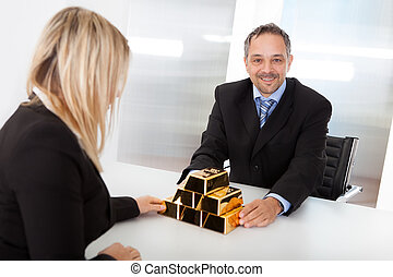 Businessman receiving gold bars - Portrait of happy...