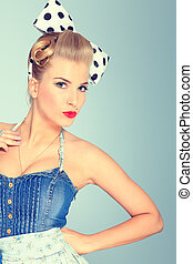 pinup girl - Beautiful young woman with pin-up make-up and...