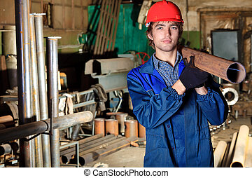 heavy industry - Industry: a worker at a manufacturing area.