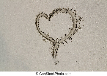 Sand Heart - A heart drawn in the sand on a beach