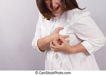 Heart attack - woman clutching her chest. in pain, possible...