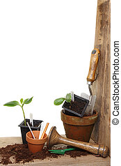 Garden tools and plants - Portrait shot of a garden potting...