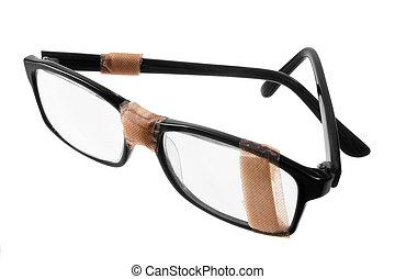 Broken Eye Glasses on White Background