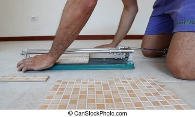 cutting tiles - tiling tool, cutting tiles close up