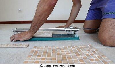 cutting tiles - tiling tool, cutting tiles close up