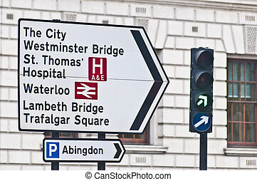 Streetsign at London, England - Streetsign pointing to...