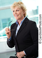 Ceo - Portrait of smiling middle aged businesswoman with...